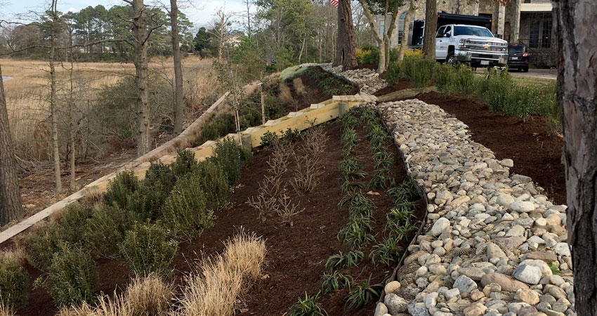 Erosion control landworks unlimited inc for Installing river rock landscaping