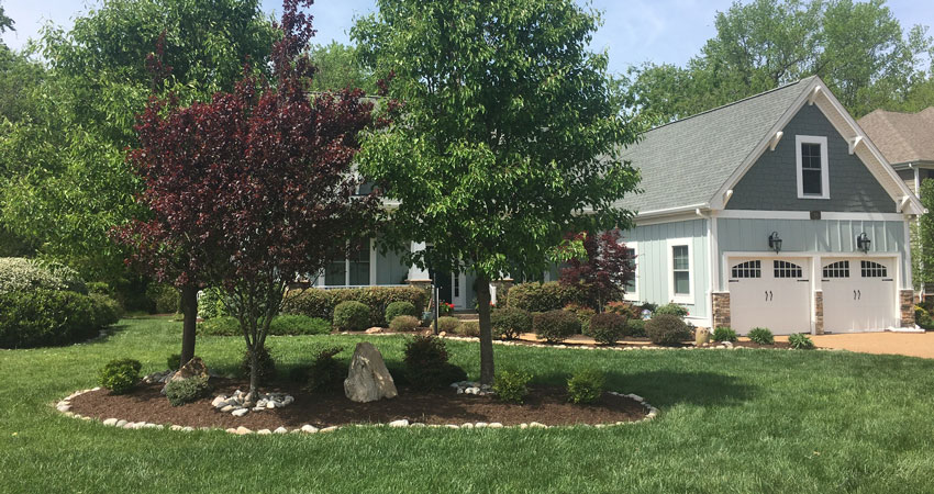 landscaping with middle flower bed
