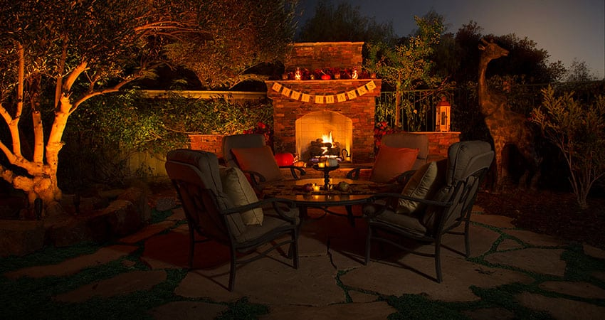 outdoor lighting on patio with fireplace